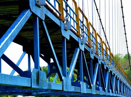 A steel bridge with a hardened pattern when applied over the blue to look gentle. Stock fotó - 131846404
