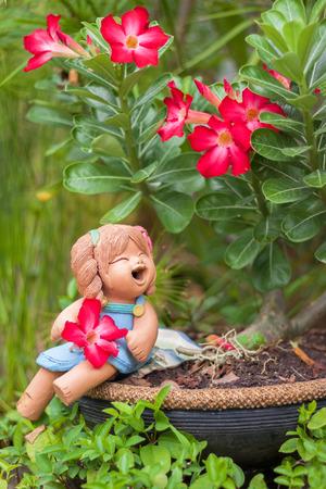blissfully: Ceramic girl under the tree