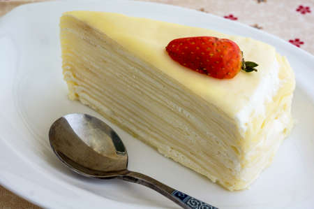 mille: Fresh vanilla crepe cake with strawberry  Stock Photo