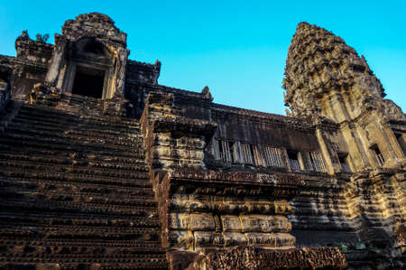 The top of the ancient Angkor Wat with blue sky   photo