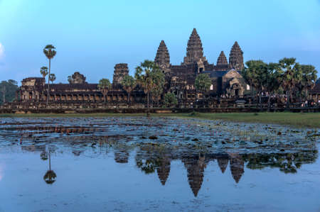 The reflection of Angkor Wat from the lotus pond in the evening photo