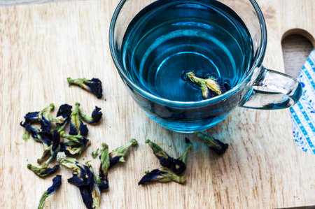 A glass of herbal butterfly-pea flower tea is good for a memory enhancer, anti-stress ,antiinflammatory and antioxidant photo