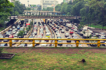 Traffic jams in Mexico City during rush hours with cross-processing filter