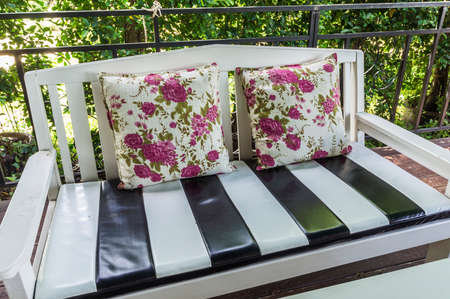 Country Style Wooden Sofa With Flower Pattern Cushions Stock Photo    30529295