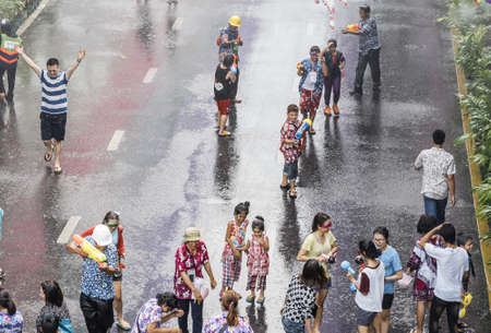 silom: BANGKOK,THAILAND-APRIL 12,2015: People has started water fight in Songkran Festival or Thai New Year on Silom Road a day earlier.