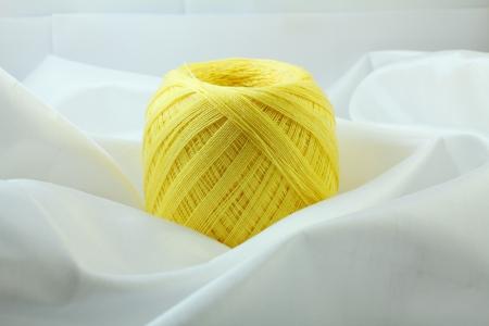 unwind: Yellow knitting wool Stock Photo
