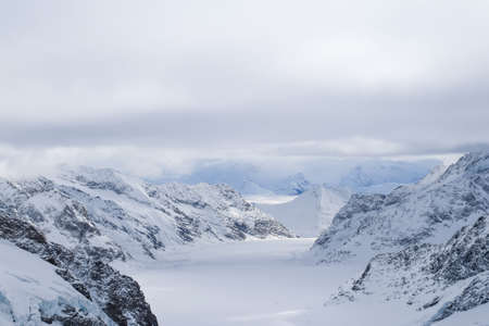 jungfraujoch: Stunning Jungfrau view of the Swiss Alps - Snow mountain at Jungfraujoch Top of Europe -  Aletsch Glacier, the largest glacier of the alps - Bernese Oberland, Switzerland