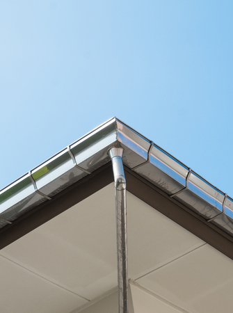 chimney corner: Rain gutter system on roof of House against Blue Sky -  Can use for illustration product Stock Photo