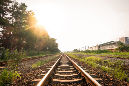 complicated journey: The railway Tracks near Ladkrabang,Bangkok,Thailand with light of sun in evening - railway transport,logistic industry background