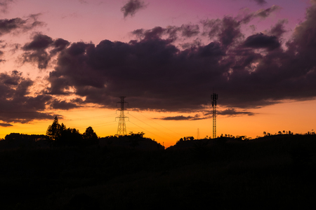 telephone pole: silhouette of high voltage and telephone pole on mountain during sunset sky with cloud