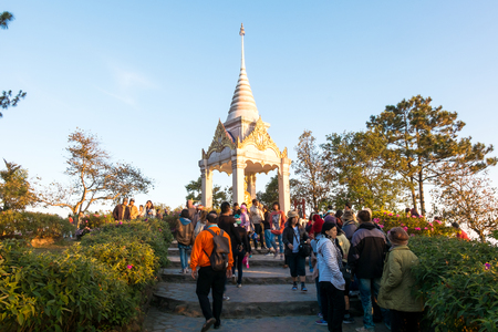 december sunrise: Loei,Thailand - December 25,2016 : the group of tourist at phu ruea after looking sunrise