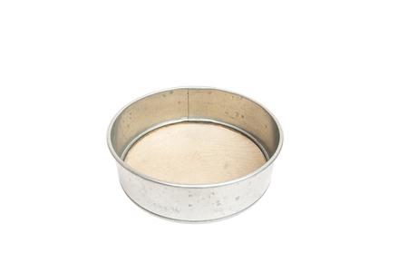 used metal sieve isolated on white background Stockfoto