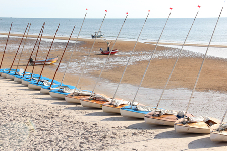 Sailing boats on the beach before sailing competition. Stock Photo