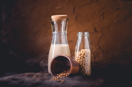 Soy Milk with some Seeds on wooden background. Reklamní fotografie