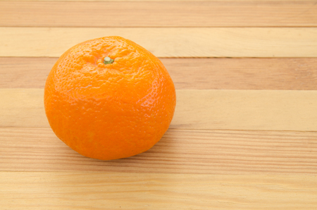 oranges on the wooden table background. Stock Photo