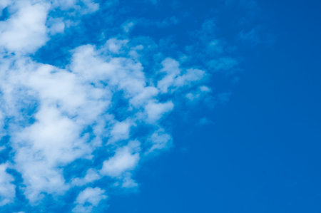 white fluffy clouds in the blue sky. Stock Photo