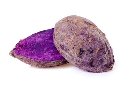 close up of burned purple yam on white background.