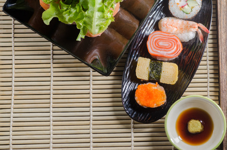Shushi Japanese Food and salad roll on wooden table. Stock Photo