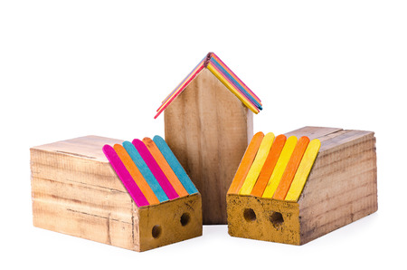 Wooden pencil box in the shape of a house in white background. Stock Photo