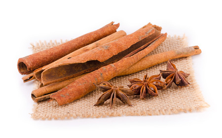Cinnamon and star anise on white background. Banco de Imagens