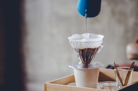 Making brewed coffee from steaming filter drip style.