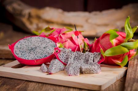 fresh sliced dragon fruit on wooden table.