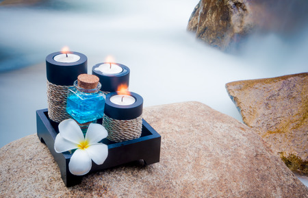spat: Spa concept,Spat setting and plumeria or Frangipani flower on waterfall background (selective focus and soft focus water)