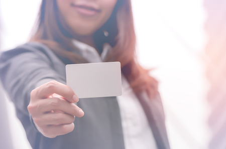 Businesswoman holding empty card,business concept