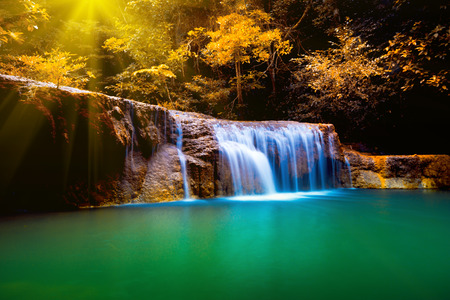 Erawan waterfall in Thailand in deep forest with sunbeam