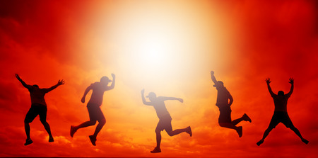 jumping people: Silhouette of jumping people in sunset