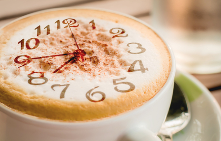 Close-up of Coffee,Cappuccino coffee cup with clock