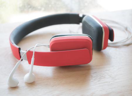 earphone: Red headphone and earphone on wood table