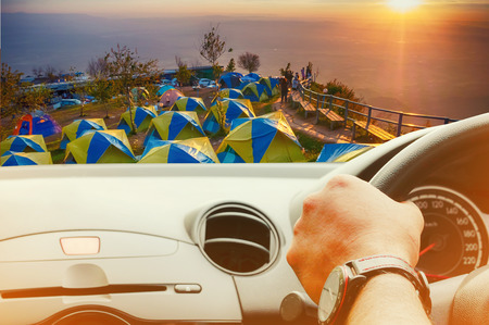 IFront view of car looking out from inside with camp on beautiful and famous travel location