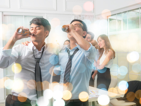Businessmen are celebrating. After the big project succeeded. On blurred bokeh background