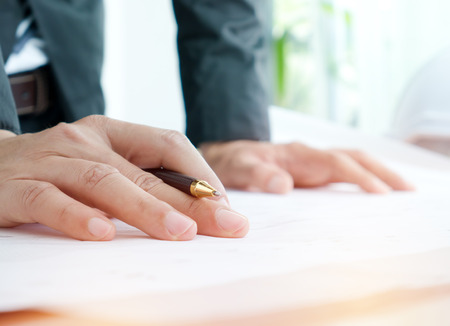 Business hand with pen on table in workplace,business concept