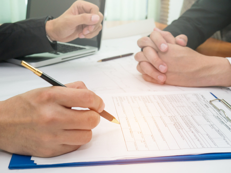 Business with partners signing a document