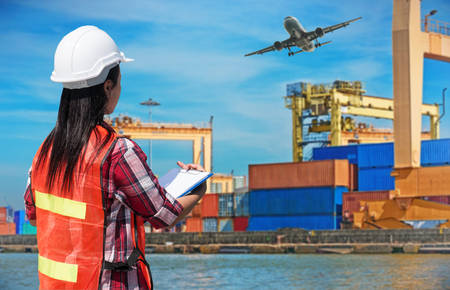 Businesswoman with safety equipment working at warehouse for Logistic Import Export concept on warehouse background 스톡 콘텐츠