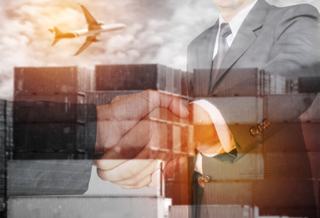 Double exposure two businessman hands shake with container and air plane ,business logistick concept.