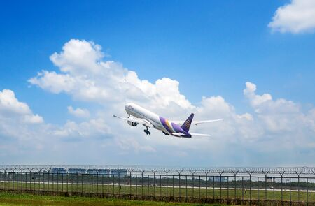 Bangkok, Thailand - March 18, 2018: THAI flies to the sky at Bangkok's Suvarnabhumi Airport. The airport is popular with tourists around the world.
