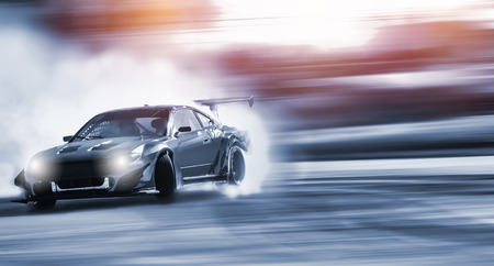 Car drifting, Sport car wheel drifting and smoking on blurred background.