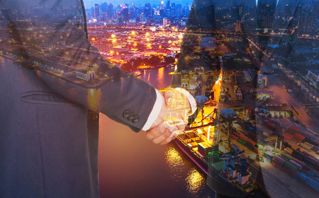 Double exposure business man hand shaking with container ship in import export and business logistic with oil terminal is industrial facility for storage of oil and petrochemical ready for transport t Foto de archivo