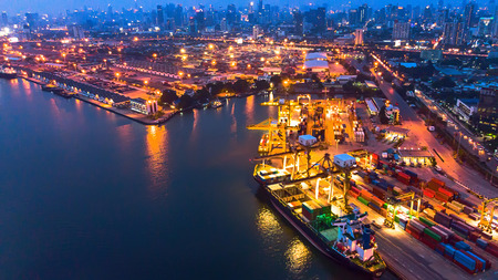 Container ship in import export and business logistic, International transportation, Business logistics concept,Aerial night view. Foto de archivo