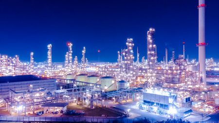 Oil storage tank with oil refinery background, Oil refinery plant at blue night sky.