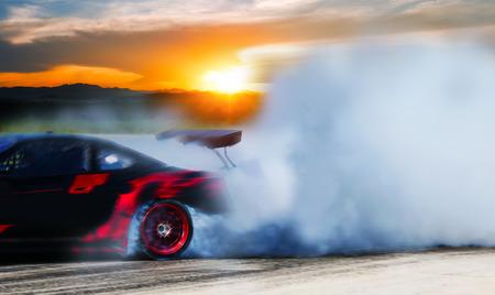 Sport car wheel drifting and smoking on track.sport concept,drifting car concept.