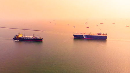 Aerial view of shipping and cargo for export and import of goods in Thailand waters at sunset.Transportation international concept.
