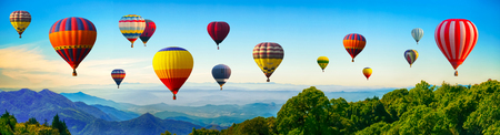 Panorama of mountain with hot air balloons on morning at Thailand. Imagens