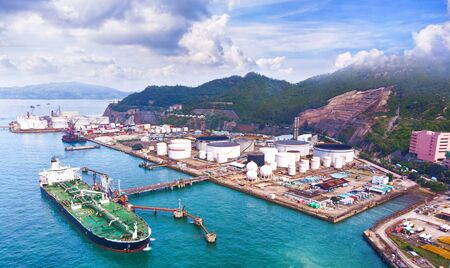 Aerial view shipping dock and Oil Refinery Manufacturing Plant.Factory of Power and Energy Industrial importexport.