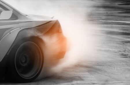 Car drifting on track with grain, Sport car wheel drifting and smoking on track. Stock fotó