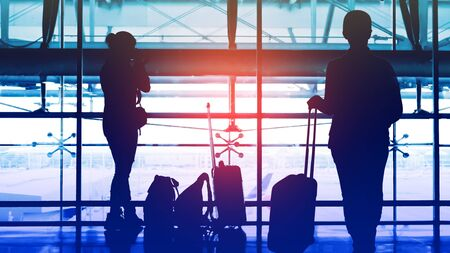 Two passengers waiting to transit flight at the airport.