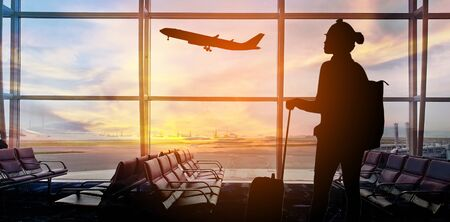 Silhouettes passenger airport. Airline travel concept. 스톡 콘텐츠